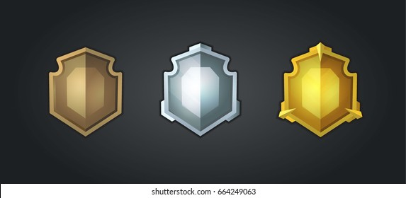 Bronze, silver, gold shields.  Set of cartoon icons for the user interface of computer games.
