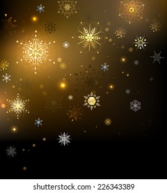 Brown Christmas glowing background with gold snowflakes.