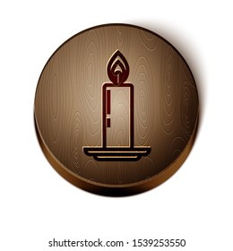 Brown line Burning candle in candlestick icon isolated on white background. Old fashioned lit candle. Cylindrical candle stick with burning flame. Wooden circle button. Vector Illustration