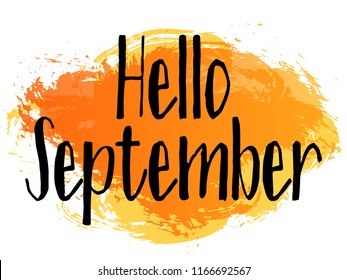 Brown and orange hello september autumn greeting banner vector design. Label with hand painted watercolor brush stroke splashes and black text. Hello to fall season, autumn banner greeting.