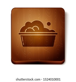 Brown Plastic basin with soap suds icon isolated on white background. Bowl with water. Washing clothes, cleaning equipment. Wooden square button. Vector Illustration