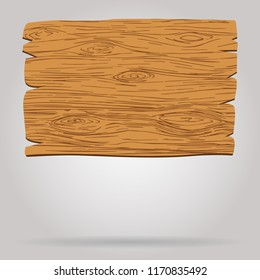 Brown wooden sign or board hanging near wall with shadow.