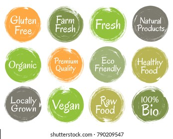 Brush painted vector organic labels, bio icons set for menu or food pack. Vegan, gluten free, fresh raw healthy food, high premium quality, locally grown eco friendly labels in green, orange, grey.