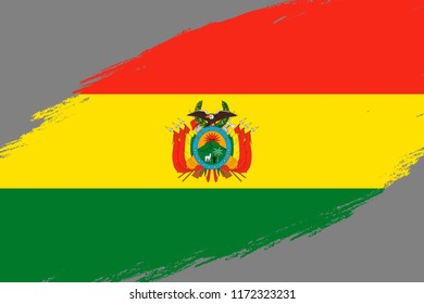 Brush stroke background with Grunge styled flag of Bolivia