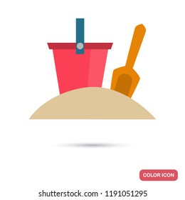 Bucket and scoop for playing in the sandbox color icon in flat design