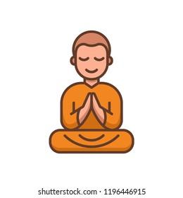 Buddhist monk in orange robes sitting in meditation