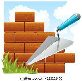 Building and construction concept. Red bricks and metal trowel outdoors.