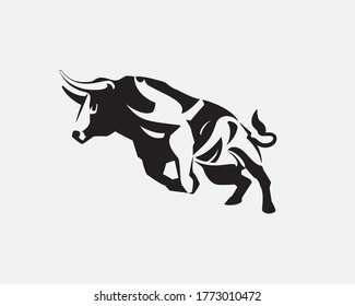 A bull is running with full of energy. Big bull rears before running. Big buffalo symbol. Bull vector icon isolated on white background. Wild bull brand logo, mascot, icon. Torro brand logo template.