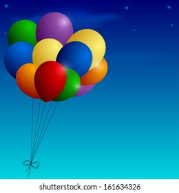 Bunch of colorful balloons on a blue sky