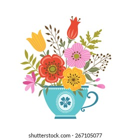 Bunch of colorful flowers in blue teacup.
