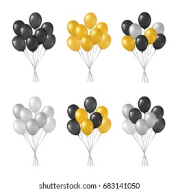 Bunches of black, golden, silver helium balloons isolated on white background.
