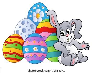 Bunny resting beside Easter eggs - vector illustration.