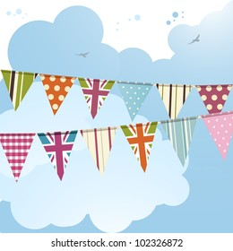 bunting background with union jack flags against a blue sky
