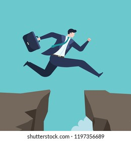 Business concept of businessman Jumping over the abyss. Challenges and success