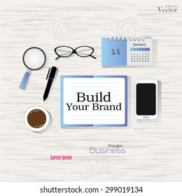 Business concept.Office desk top view with  build your brand  word. Flat design style , office equipment, working tools and other business elements on wood background.vector illustration.