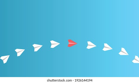 Business, creativity, innovative and solution concepts for new ideas. Group of white paper planes in one direction and one red paper plane on a blue background. copy space