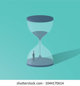 Business deadline vector concept with businessman standing in hourglass. Symbol of time pressure, countdown. eps10 vector illustration.