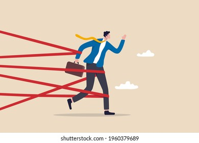 Business difficulty or struggle with career obstacle, limitation and trap or challenge to overcome to success concept, businessman tied up with red tape trying to run away with full effort.