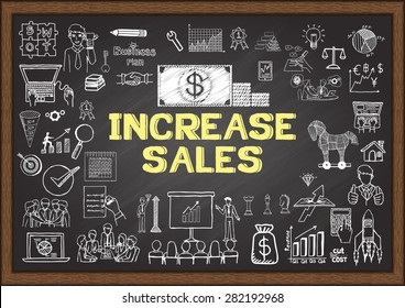 Business doodles about increase sales on chalkboard.