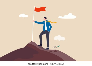 Business goal achievement, success career development or motivation and work or project accomplishment concept, confidence businessman standing proudly with victory flag on high mountain peak up hill.