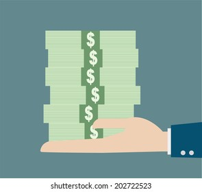 business hand holding stack money