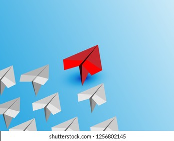 Business leadership concept with RED paper plane leading among white