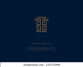 a business logo which has straight and 'L' shaped lines and letter 'T' in the middle and looks like a decorative ancient column with a capital