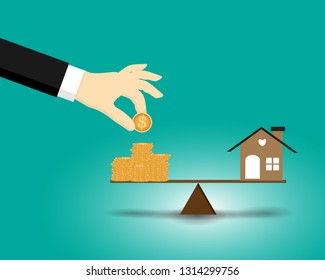 The business man dropping coin, home and coins put on the scales with balance put on the wood - Saving for buy a new house or real estate and loan for plan business investment in the future concept.