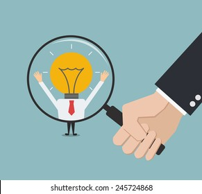 business man hand holding magnifying glass for search a creative man. Recruitment or selection concept.