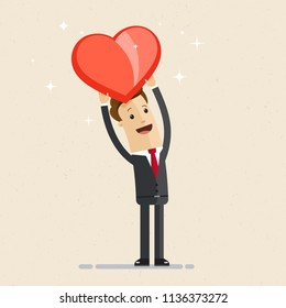 Business man showing a big red heart