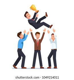 Business man team tossing in the air winner holding golden cup trophy first prize. Group of business people celebrating victory achievement throwing colleague up in the air. Flat vector illustration