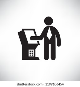 business man using atm or kiosk machine