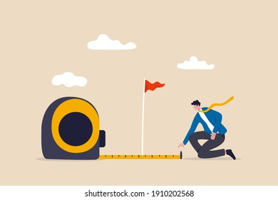 Business success measurement, how far from business goal and achievement or growth metric analysis concept, smart businessman using measuring tape to measure and analyze distance from target flag.