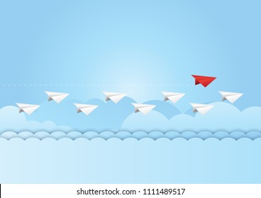 Business teamwork and leadership concept with Red paper plane leading the white group on blue sky background. Paper art vector illustration.