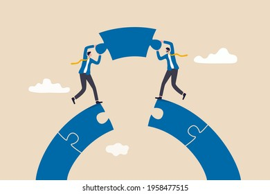 Business teamwork and partnership help to achieve team success, think together to solve business problem, business connection concept, businessmen working team building connect jigsaw puzzle bridge.