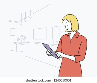 business woman and her working space. hand drawn style vector design illustrations.