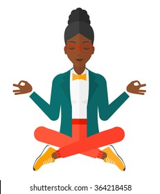 Business woman meditating in lotus pose.