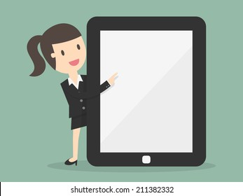 Business woman pointing to the screen of a tablet-pc