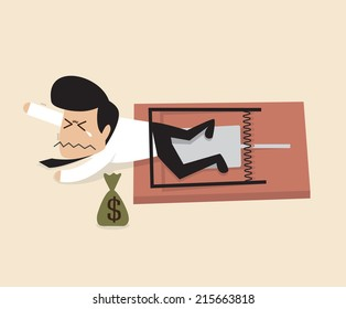 Businessman is caught by a mouse trap