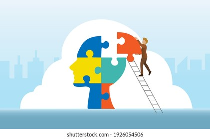 Businessman connecting jigsaw puzzles missing pieces in human head shape. Inspiration, partnership, team building and strategy solution concept.