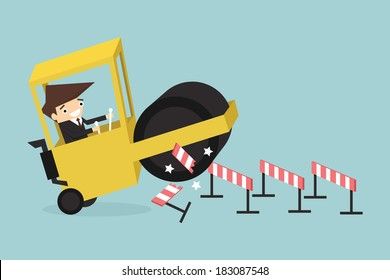 Businessman driving a road roller over an obstacle