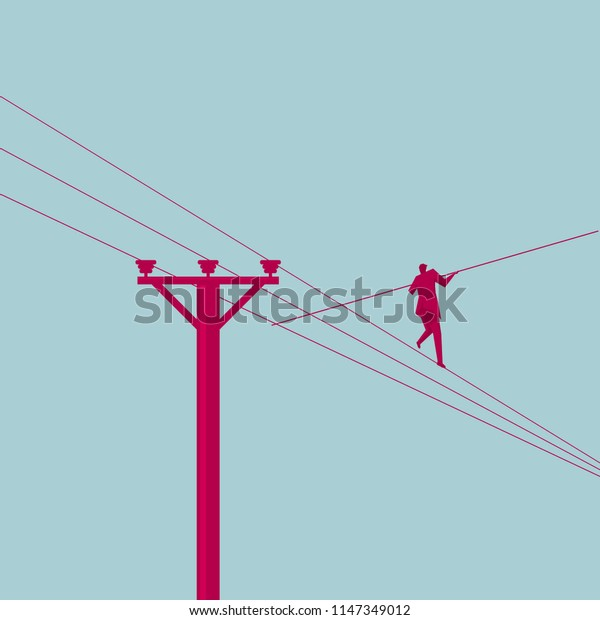 Businessman in equilibrium on the cable.Business concept.