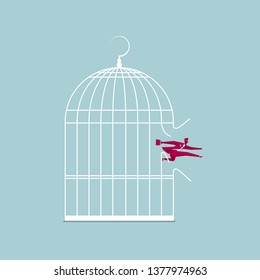Businessman escaped from the cage. Isolated on blue background.