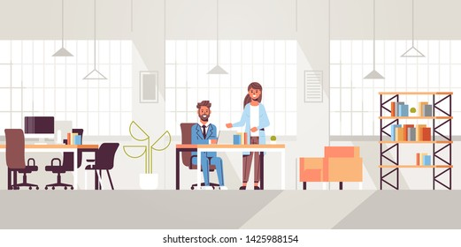 businessman with female assistant using laptop discussing new project during meeting at workplace teamwork concept creative workspace modern office interior flat full length horizontal