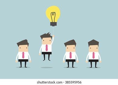 Businessman flying out by light bulb of idea