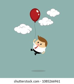Businessman is flying with red balloon