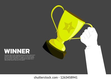 Businessman Hand with Gold trophy cup award. background concept for first place winner and victory
