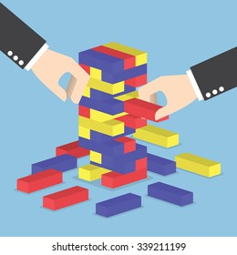 Businessman hands play wood block tower game, Teamwork, Strategy and Vision concept
