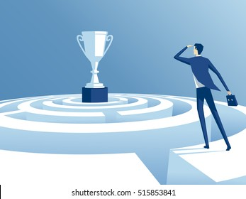 businessman has climbed to the top of the maze and trying to find the way to the cup, worker looks how to get through the maze and get a prize. business concept the way to victory
