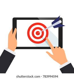 Businessman hold tablet and point on the screen with the dart of target concept vector illustration